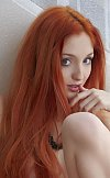 Beautiful redhead showing of her beautiful body and shaved pussy